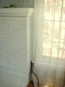 Cords covered by the wood piece painted the wall color